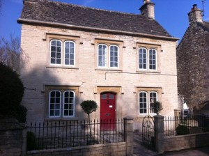 Stone house front after cleaning & repointing